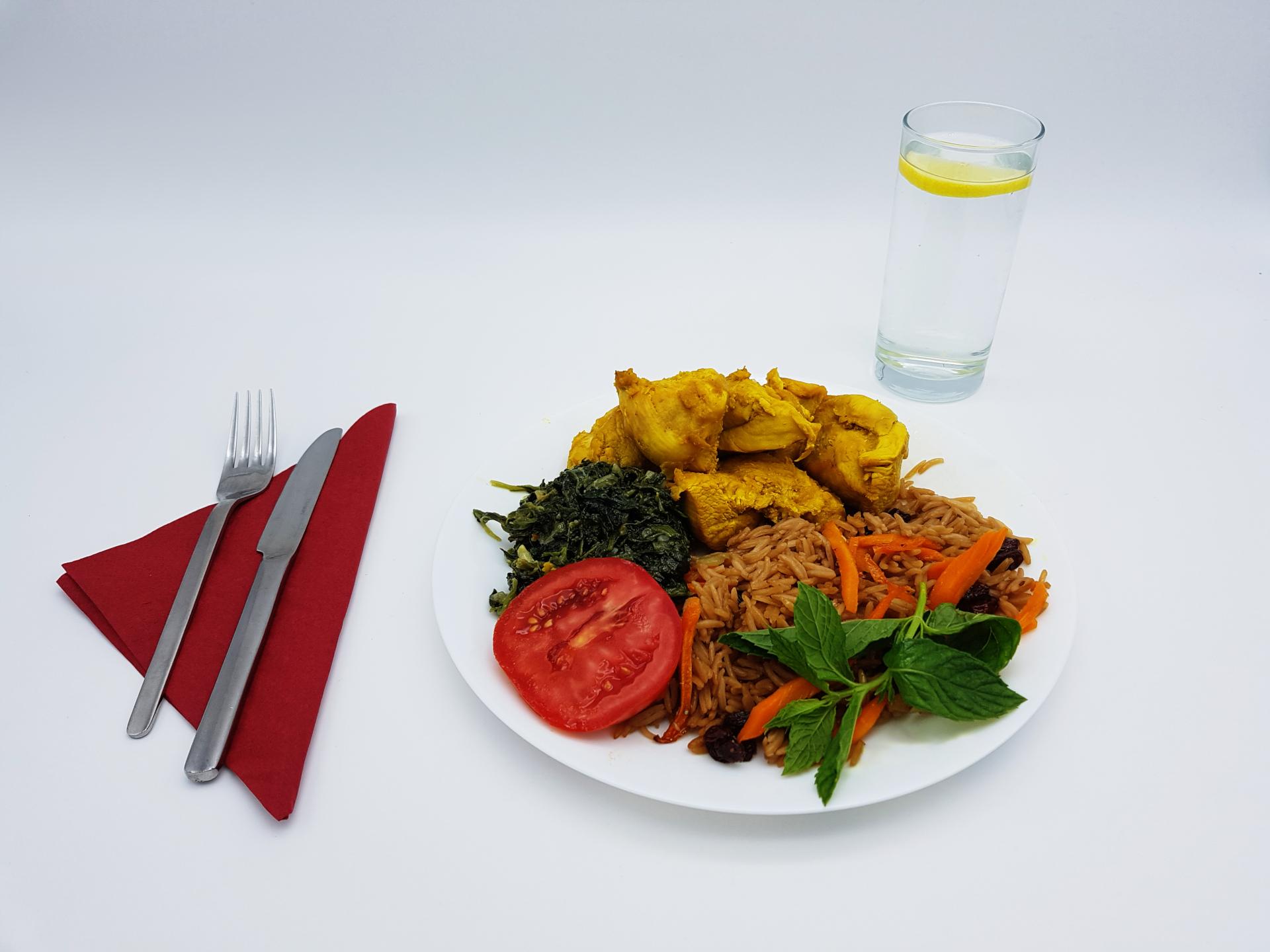 Genießen Sie leckeres Hühnchenfleisch und brauner Basmatireis im Restaurant Kabul in Wuppertal.